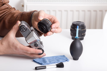 Old camera and lens in male hand