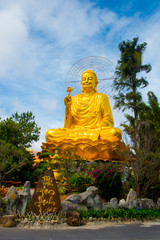 Religious monument, seated gold Buddha