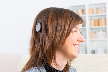 Woman showing cochlear implant