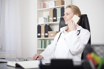 Happy Female Clinician Calling on Mobile Phone