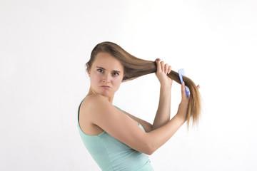 humorous woman combing hair