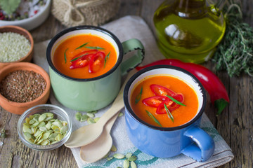 Pumpkin soup puree with hot pepper and herbs. Soft focus