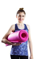 Fit brunette holding yoga mat