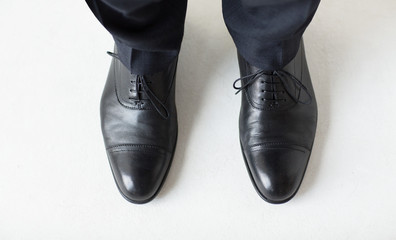 Wall Mural - close up of man legs in elegant shoes with laces
