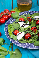 Healthy diet salad with tomatoes, mozzarella,basil and balsamic