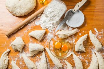 hand made bread dough cut and prepare into bread rolls