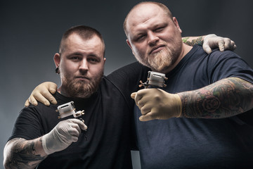 Two mans tattoo artists