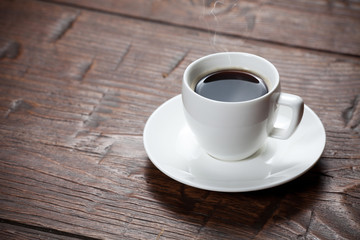 Coffee cup and saucer on wooden table