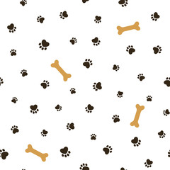 Dog theme seamless pattern with paw footprints and bones