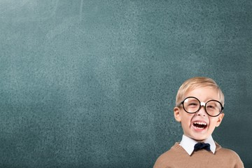 Teacher. Cheerful smiling boy on a green background.
