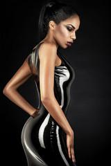 Portrait of sexy woman in black latex dress