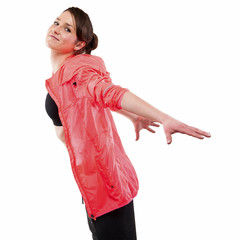 modern style dancer posing with hands on back in studio backgrou