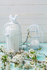 Flowering tree branches and decorative bird cages