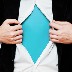 Businessman showing a copy space under his shirt