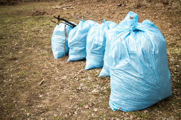 Blue garbage bags on ground