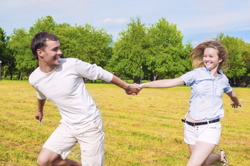 Youth Lifestyle: Caucasian Couple Relaxing Outdoors. Man Draggin