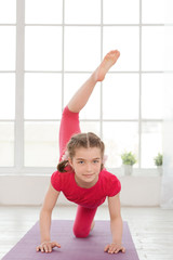 Little girl doing yoga exercise