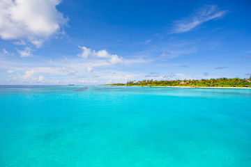 Idyllic tropical beach with white sand and perfect turquoise