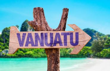 Vanuatu wooden sign with beach background