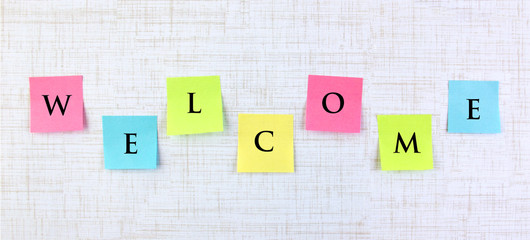 Welcome banner with sticky notes