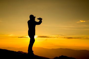 .Businessman watch binoculars for his vision