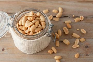 raw peanuts in glass jar