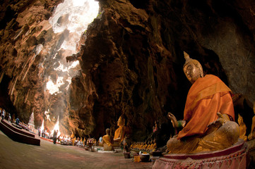 Buddha statue inside cave of the mountain in Khao Luang