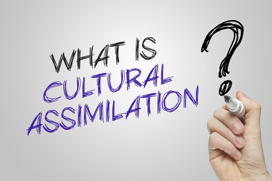 Hand writing what is cultural assimilation