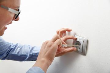 Businesswoman installing a power socket