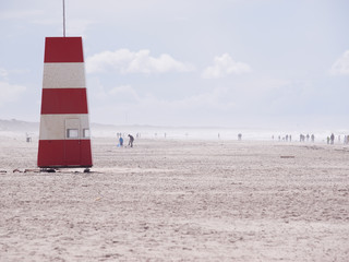 Red-and-white tower at the beach