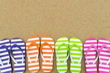 Multicolor sandals on beach