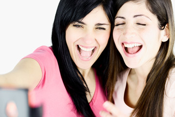 Closeup of girls laughing taking picture with smart phone
