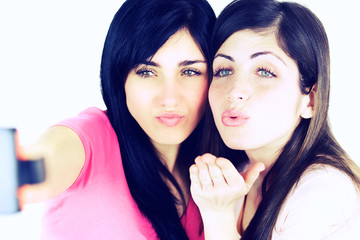 Cute beautiful girls blowing kiss taking selfie