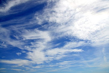 Light blue sky with clouds as background