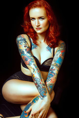 Beautiful girl with  tattooed arms,,