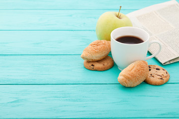 cup of coffee, cookies on blue wooden background