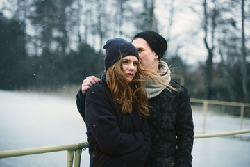 couple of lovers on the quay in winter