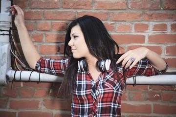 Brick wall woman