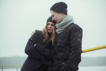 beautiful couple in love on the waterfront