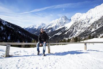 Young man enjoys winter landscape