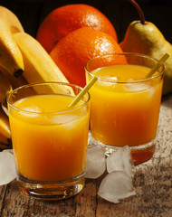 multifruit citrus juice from oranges, lemons, bananas in a glass