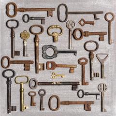 Rusty keys on wooden background