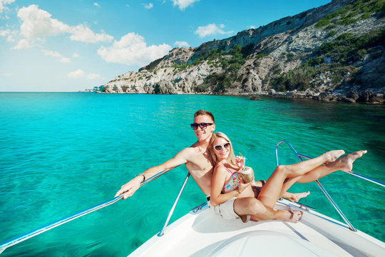 Couple resting on a yacht at sea. Luxury holiday vacation.