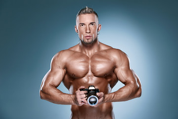Attractive male body builder onblue background