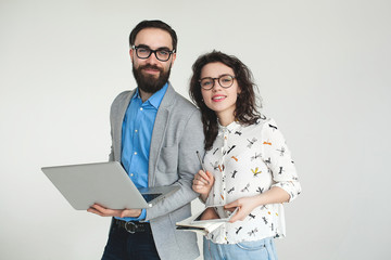 Hipster team in glasses with laptop tablet isolated on white