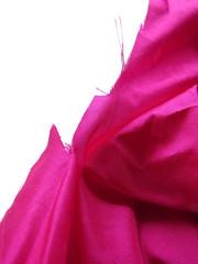Pink silk unravels