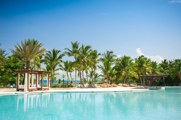 Outdoor Swimming pool of luxury hotel resort near the sea