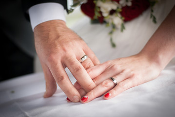 Wedding rings on fingers