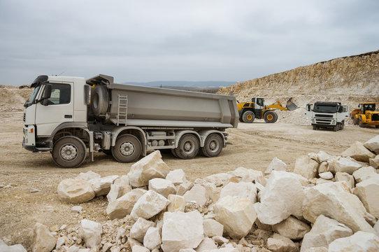 Trucks and bulldozers in quarry