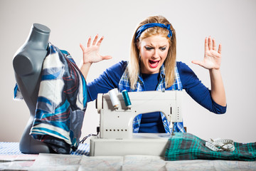 Woman sews and getting frustrated because she made a mistake